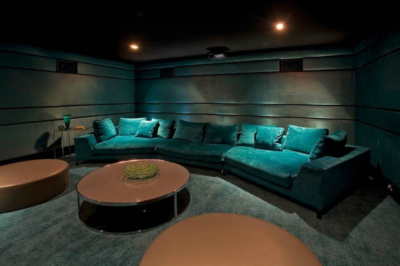 Basement With Media Room And Suede Leather Sofa