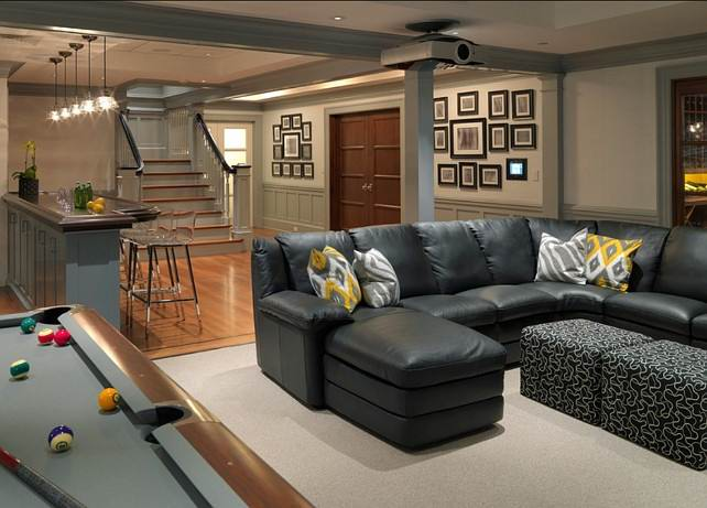 This Basement Features a Media Room, a Pool Table And a Bar